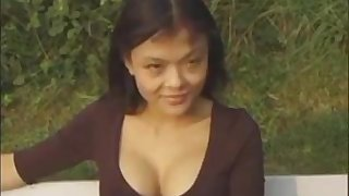 Asian slut fucked by a big cock outdoors