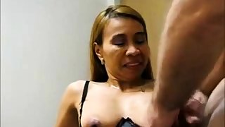 Adult Asian takes a load on her tits