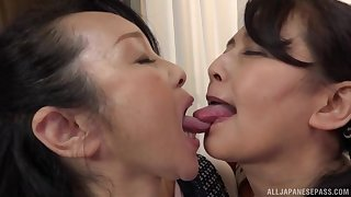 Chubby Japanese masture gets her pussy fingered overwrought a lesbian lady