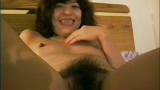 Lewd untrained Asian nympho tickles her bushy pussy with the addition of sucks dick